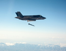 An F-35B short take-off and vertical landing (STOVL) fighter aircraft piloted by Marine Corps Maj. Richard Rusnok, successfully employed a Guided Bomb Unit-12 (GBU-12) Paveway II laser-guided weapon from the F-35's internal weapons bay against a fixed ground tank test target yesterday.