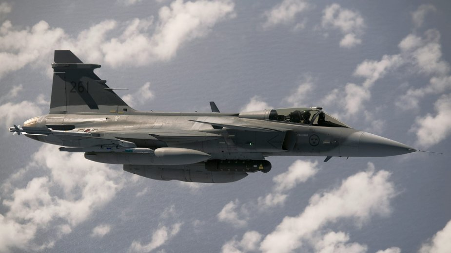 Saab JAS 39C Gripen of Swedish Air Force dropped 500 lbs bomb on forest fire