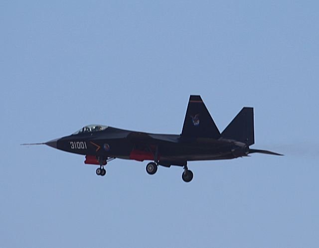 "China officially pulled the curtain back on its new fourth-generation stealth fighter — the Shenyang J-31 ""Falcon Eagle"" — during the Airshow China 2014 exhibition in Zhuhai. The J-31 represents China's chief competitor for arms market share against the U.S.'s F-35 Joint Strike Fighter."