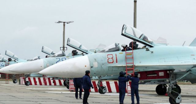 Fourteen Russian fighter jets are scheduled to land in Crimea's Belbek military air base, Capt. 1st Rank Vyacheslav Trukhachev, a spokesman for Russia's Black Sea Fleet, told Russian news agency RIA Novosti. The fighter jets are comprised of ten upgraded Su-27SM's and four Su-30's. All of them are fourth-generation fighter jets. Four of the aircraft deployed in Crimea are newly manufactured, according to Trukhachev.