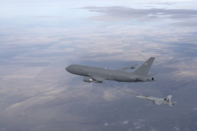 USAF KC 46 tanker completes first in flight refueling with F A 18 fighter aircraft 640 001
